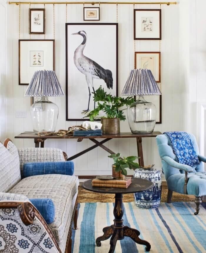 Living room with bird print wall Southern Living Idea House Amelia Island Instagram