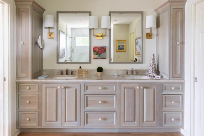 main bath with blue lightly stained cabinetry photo by Lynn Tennille
