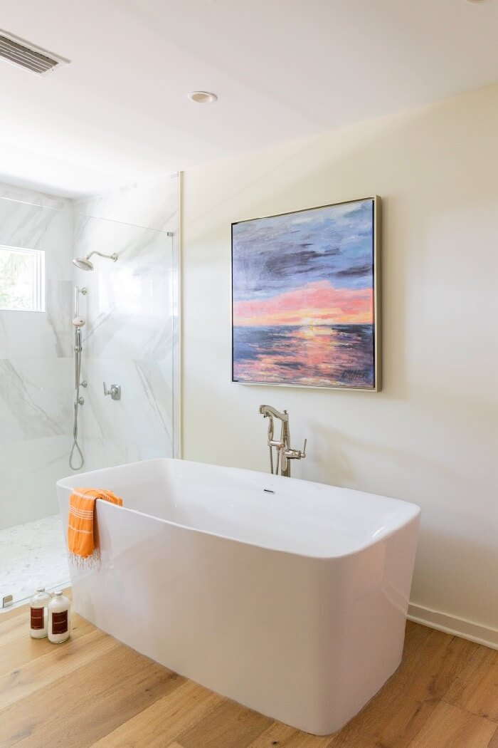 Soaking tub and large walk in shower with window for natural light painting by Kathy Miller Amelia Sunrise photo by Lynn Tennille