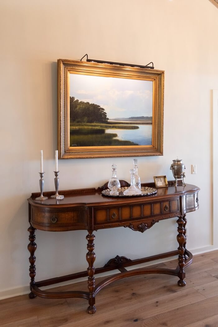 Dramatic marsh painting over dining room buffet photo by Lynn Tennille