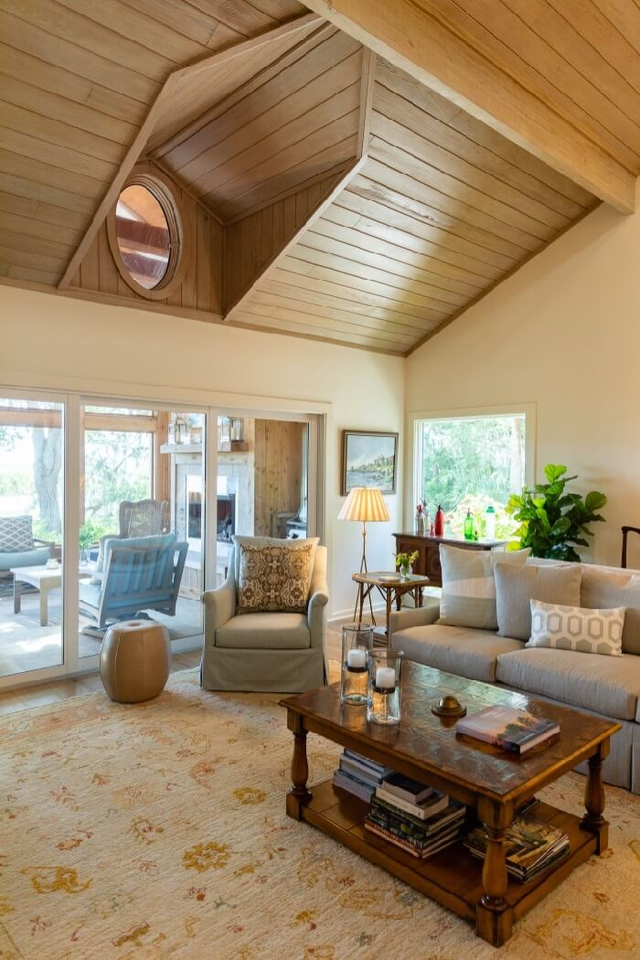 Living area with view through screened porch to the marsh photo by Lynn Tenille