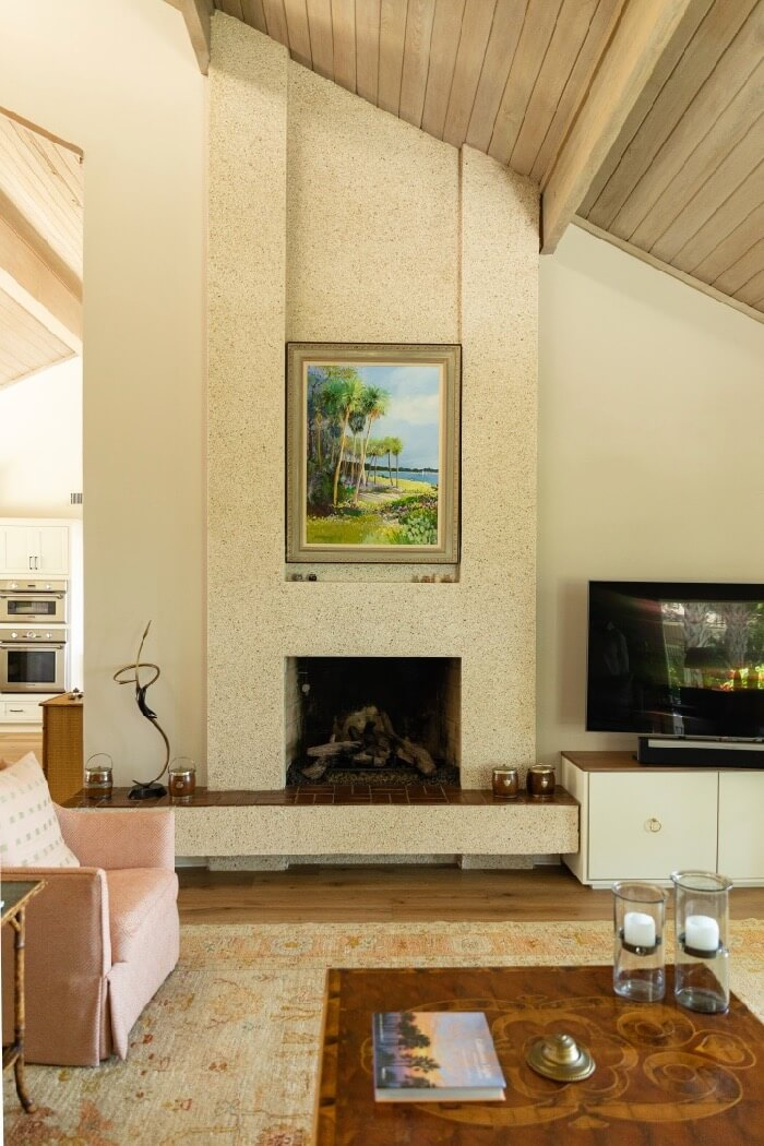 Coquina fireplace original to the house photo by Lynn Tennille