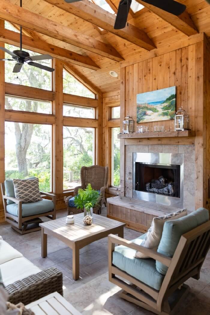 Screened porch with fireplace and Kathy Miller original's beach painting photo by Lynn Tenille