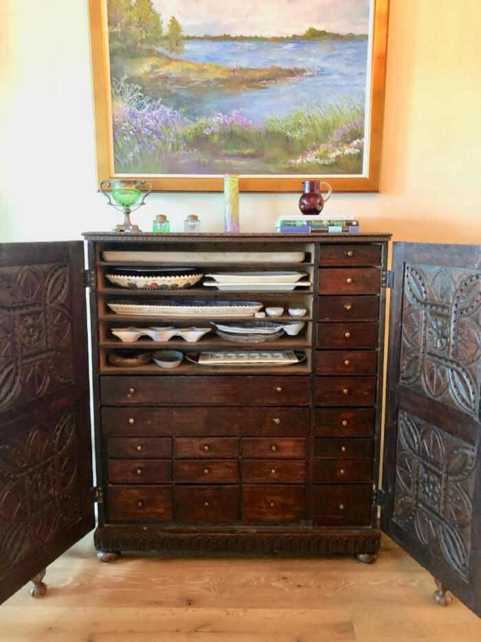 Apothecary Cabinet with platters and lots of drawers photo by Kathy Miller