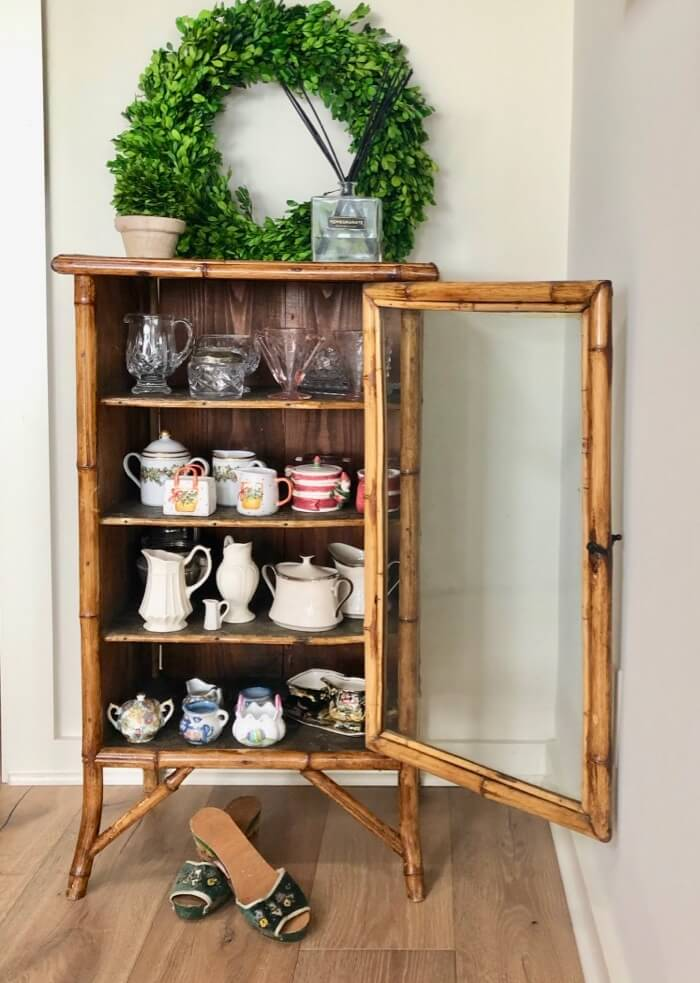 antique bamboo cabinet with sugar and creamer collection photo by Kathy Miller