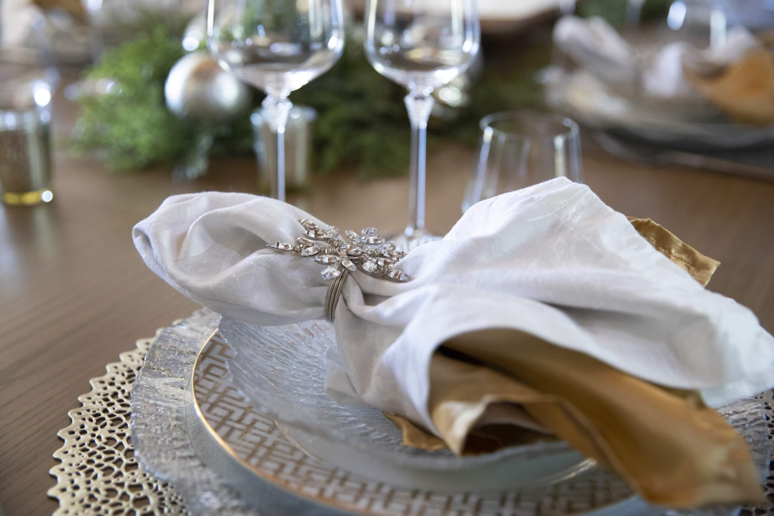 Christmas table setting using gold, silver, crystal and greenery photo by Clay Greenhaw