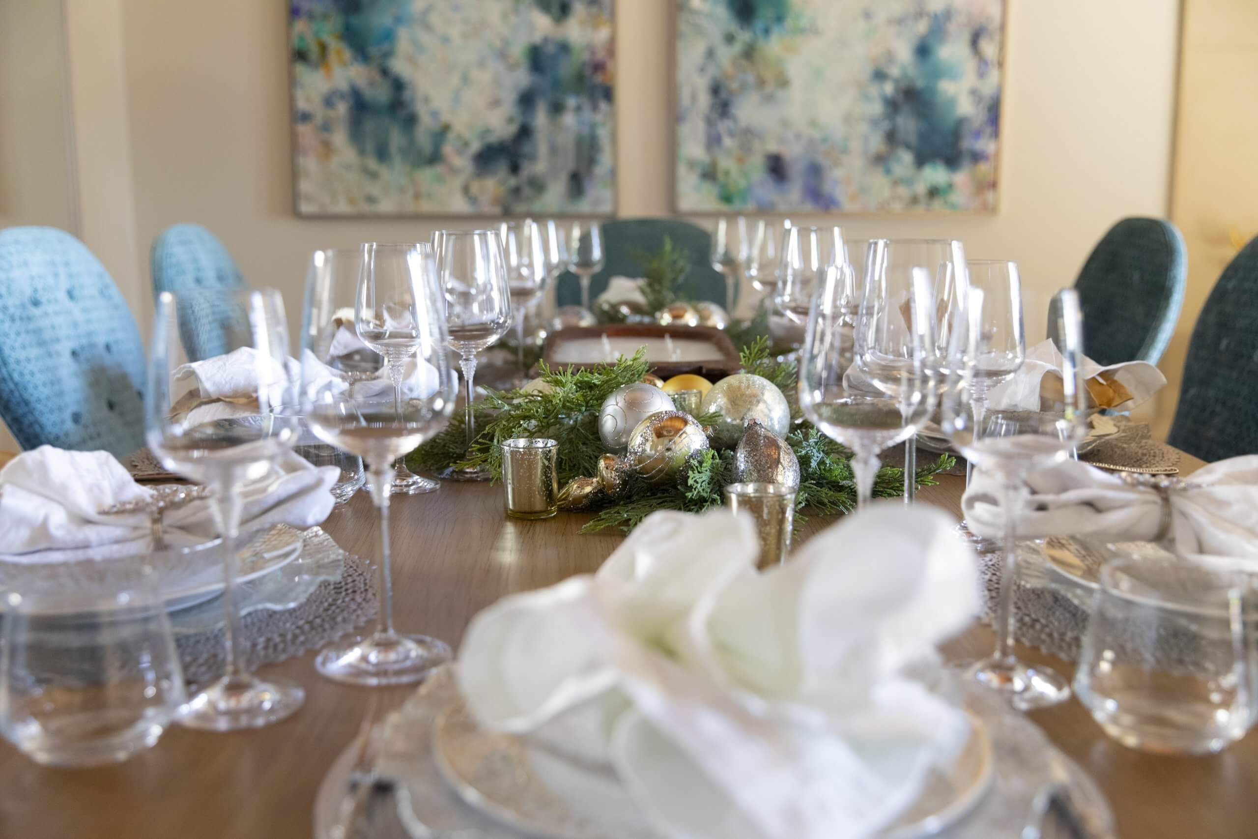 Blair Sheffield Christmas dining room table with 2 Casey Matthews paintings photo by Clay Greenhaw