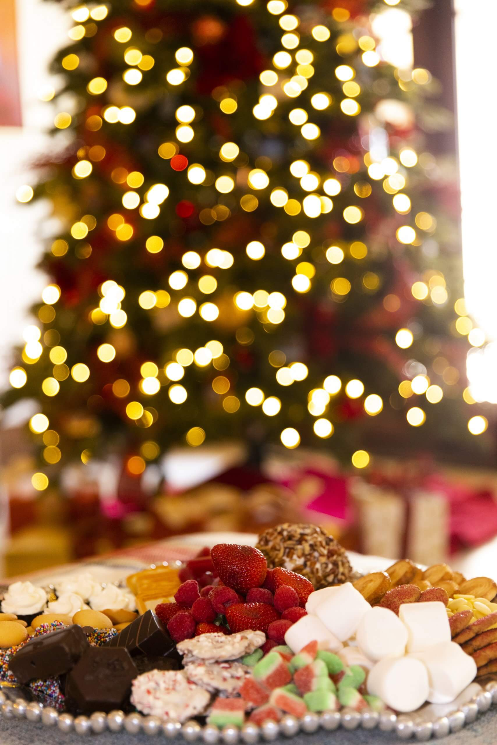 Dessert charcuterie board with red, green gold Christmas tree photo by Clay Greenhaw