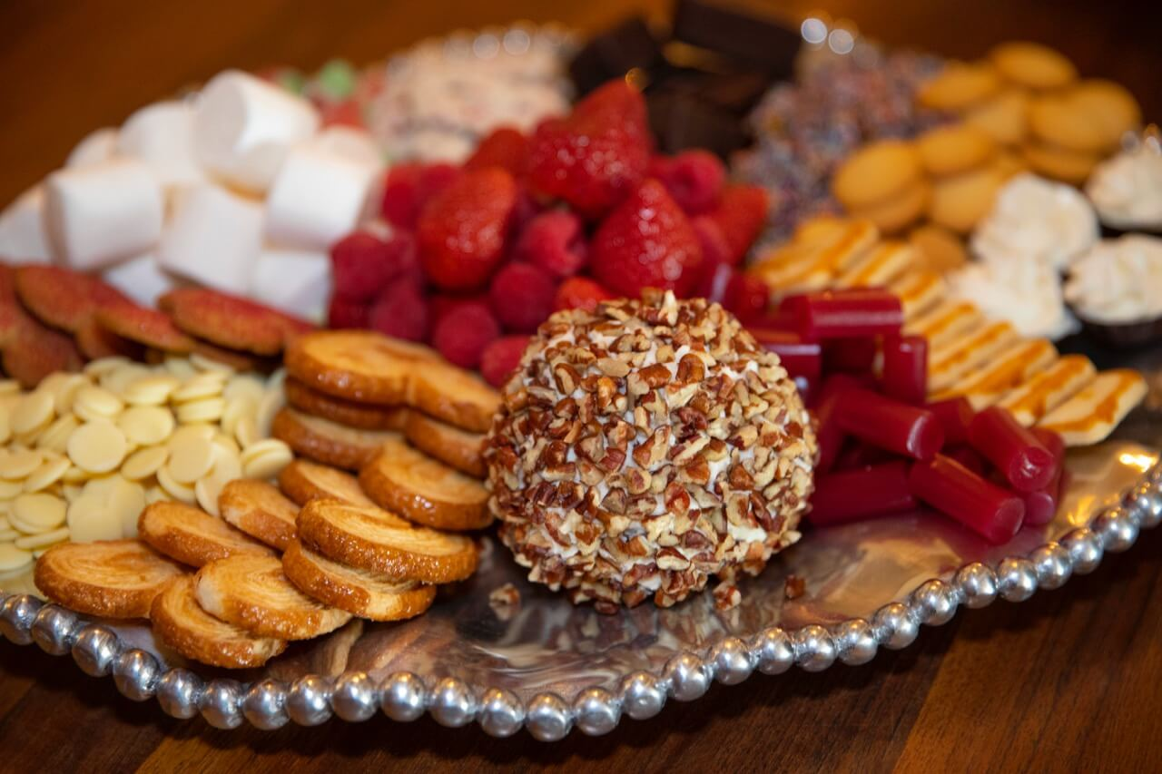 Dessert tray with Chocolate chip cheese ball and cheesecake chocolate tarts photo by Clay Greenhaw