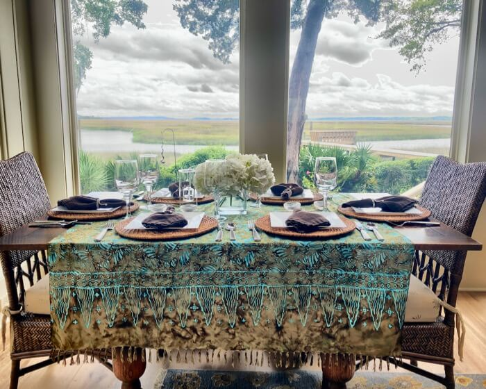 Batik fringed shawl as a table cloth with browns and turqs photo by Kathy Miller