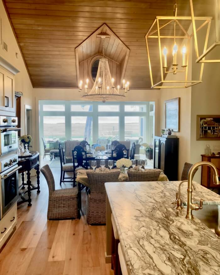 View from kitchen through dining space and sunroom to marsh photo by Kathy Miller