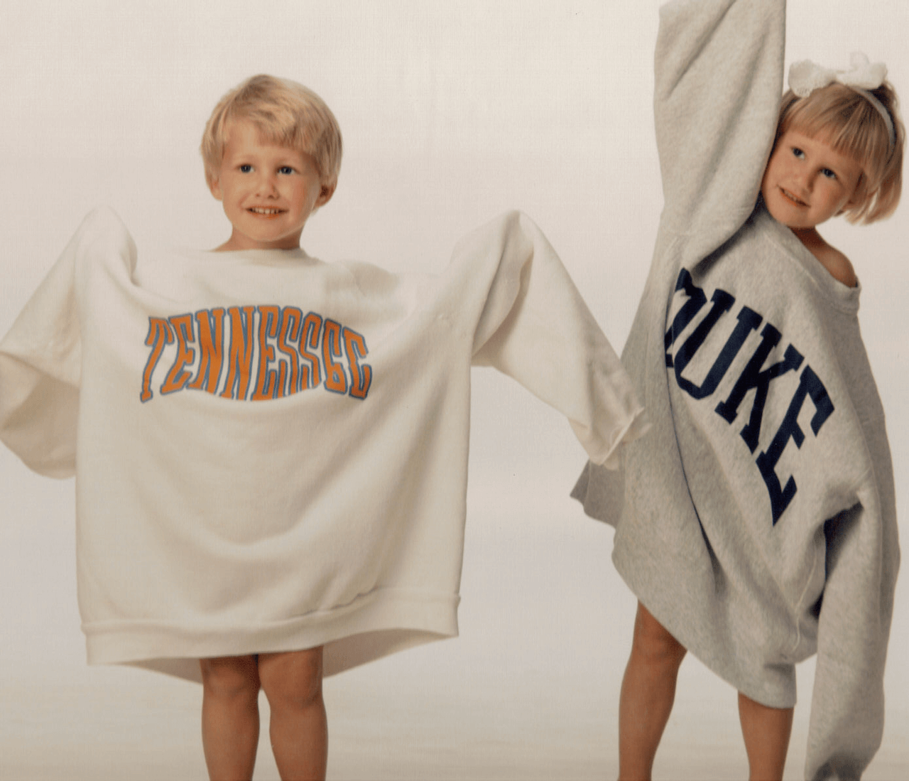 James and Lizzy in Tennessee Duke sweatshirts photo by Kathy Miller
